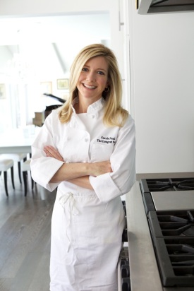 chef carrie head shot in kitchen with arms crossed